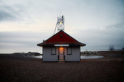The Leuty Lifesaving Station, early dawn. Since it was built in 1920 by Chapman and Oxley architects, the Leuty Lifeguard Station has helped to save thousands of lives. Over the years it has been moved four times to keep it close to Lake Ontario's edge. During the 1980's the Leuty had fallen into disrepair and was threatened with demolition. Local residents formed S.O.S. (Save Our Station), and enough money was raised to restore the structure. It has since been declared an important historic site by the Toronto (Canada) Historical Board.<br /> <br /> + Exposure f/5.6 @ 1/60<br /> + Time 7:47A<br /> + Edition Size 150 Limited; 25 Artist Proof