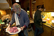 (MODEL RELEASED IMAGE). Working together in the kitchen to prepare dinner for guests, Jörg and Susanne prepare rouladen, a traditional German entrée consisting of pickles, mustard, and Westphalian bacon, rolled up in a thick slice of beef, cooked, and served in rich brown gravy. This is a favorite meal of the Melander family. (Supporting image from the project Hungry Planet: What the World Eats.)