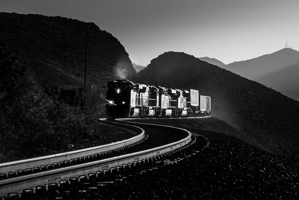 A Union Pacific intermodal train crests the grade from the Las Vegas basin en route to los Angelas.