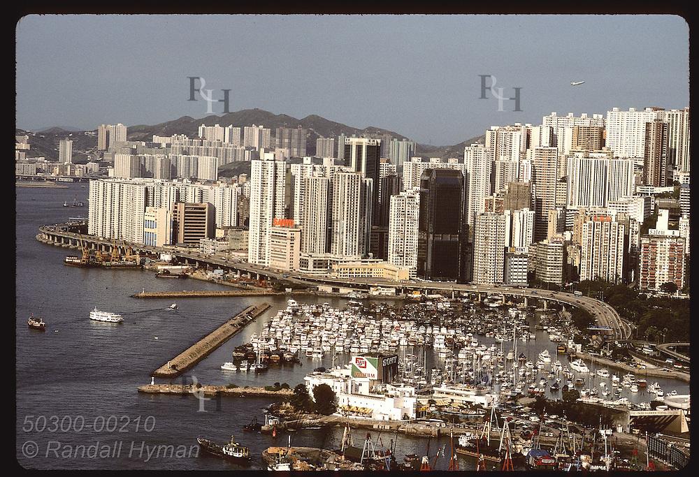 Hi-rises line Causeway Bay and yachts fill Causeway Bay Typhoon Shelter on sunny day;aerial view Hong Kong