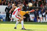 Sean Rigg of Newport county (l) gets to the ball ahead of Daniel Parslow of Cheltenham Town. EFL Skybet football league two match, Newport county v Cheltenham Town at Rodney Parade in Newport, South Wales on Saturday 10th September 2016.<br /> pic by Andrew Orchard, Andrew Orchard sports photography.