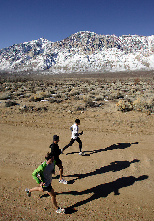 BISHOP, CA, January 19, 2008: Ryan Hall, in white shirt, trains for the Olympics with Mike McKeeman, left, and Steve Slattery,at the base of the Eastern Sierra mountains outside the town of Bishop, California about 30 miles from Mammoth Lakes. The high altitude and clean air provide a picturesque and challenging training ground for the Olympic hopeful.