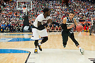 29 MAR 2015: Denzel Valentine (25) of Michigan State University dribbles in on Montrezl Harrell (24) of the University of Louisville during the 2015 NCAA Men's Basketball Tournament held at the Carrier Dome in Syracuse, NY. Michigan State defeated Louisville 76-70 to advance. Brett Wilhelm/NCAA Photos