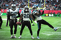 American Football - 2019 NFL Season (NFL International Series, London Games) - Tampa Bay Buccaneers vs. Carolina Panthers<br /> <br /> Jordan Scarlett (20) for the Panthers, celebrates  his steal, at Tottenham Hotspur Stadium.<br /> <br /> COLORSPORT/ANDREW COWIE