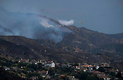Fire fighting plane drop water on a brushfire, Sunday, Sept. 3, 2017, in Burbank, Calif. Several hundred firefighters worked to contain a blaze that chewed through brush-covered mountains, prompting evacuation orders for homes in Los Angeles, Burbank and Glendale.(Photo by Ringo Chiu)<br /> <br /> Usage Notes: This content is intended for editorial use only. For other uses, additional clearances may be required.