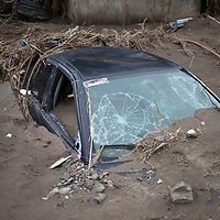 A car buried in the silt from flooding in San Pedro Sula after hurricanes Eta and Iota.