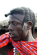 Kenya, Masai Mara, Masai (Also Maasai) Tribesmen an ethnic group of semi-nomadic people. Warriors with traditional headdress