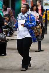 Mariama Sesay, 32, who is accused of stalking another woman, including threats to kill, arson and damaging tyres as well as sending text messages to the alleged victim's son, including a picture of a firearm, leaves Uxbridge Magistrates Court. Uxbridge, June 20 2018.