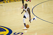 Golden State Warriors forward Draymond Green (23) dribbles the ball down the court during a NBA preseason game against the Los Angeles Clippers at Oracle Arena in Oakland, Calif., on October 4, 2016. (Stan Olszewski/Special to S.F. Examiner)