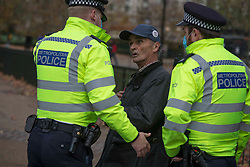 © Licensed to London News Pictures.21/11/2020. London, UK. Anti-mask and lockdown protestors gather in Hyde Park during a March for our Freedom demonstration in central London. Photo credit: Marcin Nowak/LNP