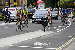 © London News Pictures. 25/08/2016. Cyclists ignore the cycle lane and chose to join moving traffic while travelling along Abingdon Street in Westminster. Cyclists repeatedly ignore new cycle lanes installed around westminster in central London. Between the hours of 8am and 9am on Wednesday 24/08/2016, 266 (two hundred and sixty six) cyclists passed through the red light at one of the newly installed  bike lanes and only 15 (fifteen) cyclists stopped.  The light system is designed to allow either vehicles or cyclists to pass at one time in order to make the junction safer for cyclists..... **VIDEO AVAILABLE** Photo credit: London News Pictures.