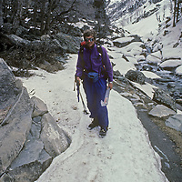 Photographer Gordon Wiltsie stumbles out of India's Great Himalaya Range after crushing two vertebrae in an avalance near the end of the first-ever ski traverse from Ladakh to Kashmir.
