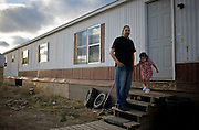 """Simpson Little Light, 27, was born in Billings, MT but moved to the Crow Indian Reservation at a young age. Like many of the non-married single parents on the reservation, he lives with his mother and father. """"I'm hoping to move back to Billings eventually,"""" said Little Light. """"There's more opportunity for a good education in the big city."""""""