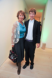 CELIA IMRIE and her son ANGUS  at an exhibition of photographic portraits by Bryan Adams entitled 'Hear The World' at The Saatchi Gallery, King's Road, London on 21st July 2009.