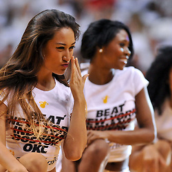 Jun 17, 2012; Miam, FL, USA; A Miami Heat dancer blows a kiss to fans during a second quarter performance during game three in the 2012 NBA Finals against the Oklahoma City Thunder at the American Airlines Arena. Mandatory Credit: Derick E. Hingle-US PRESSWIRE