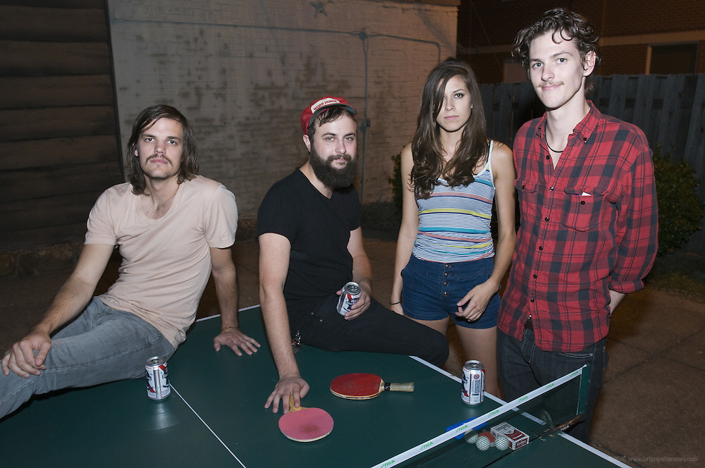 Houndmouth band members take a break from practice as they enjoy a few moments outside on the patio Friday, Aug. 17, 2012, at the home of drummer Shane Cody in New Albany, Ind. From left are Zak Appleby, Shane Cody, Katie Toupin and Matt Myers. (Photo by Brian Bohannon)