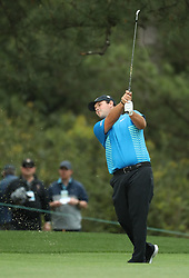 April 7, 2018 - Augusta, GA, USA - Patrick Reed hits from the 1st fairway during the third round of the Masters Tournament on Saturday, April 7, 2018, at Augusta National Golf Club in Augusta, Ga. (Credit Image: © Jason Getz/TNS via ZUMA Wire)