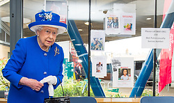 Queen Elizabeth II during a visit to the Westway Sports Centre, London, which is providing temporary shelter for those who have been made homeless in the Grenfell Tower disaster.