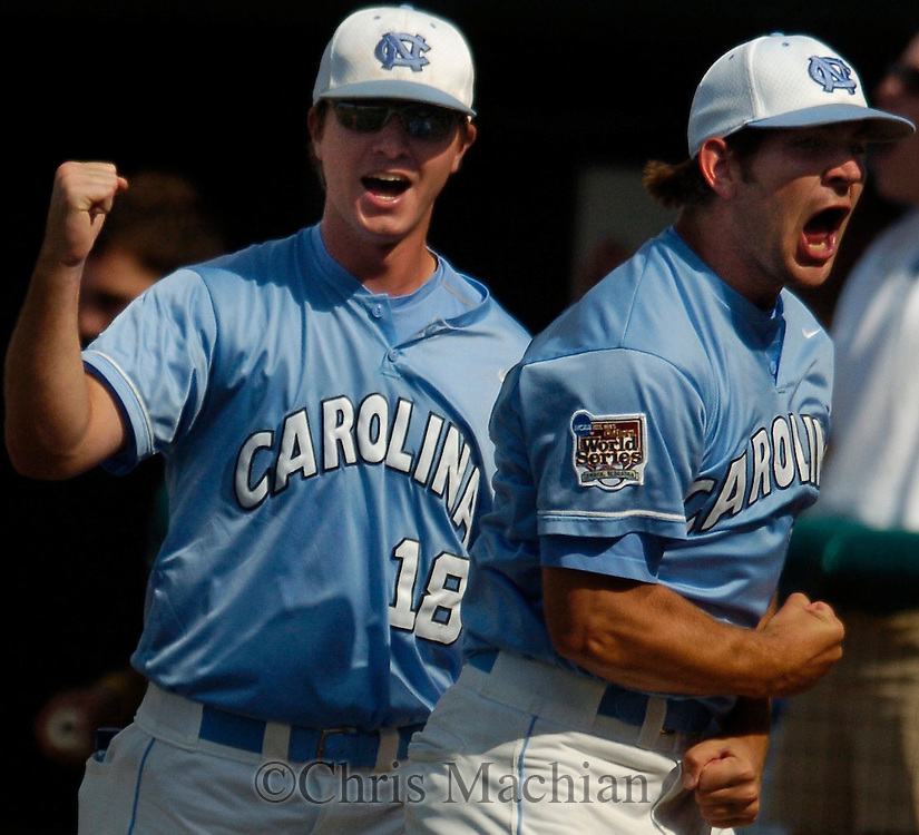 06/20/2006 North Carolina's Mike Facchinei (left) and Andrew Carignan react to a three-run home run by Jay Cox during the third inning of game eleven of the College World Series in Omaha Nebraska Wednesday afternoon..(photo by Chris Machian/Prairie Pixel Group)