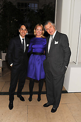Left to right, FRANCOIS LE TROQUER MD Cartier UK, KATE REARDON and ARNAUD BAMBERGER Executive Chairman Cartier UK at a reception to present the new Cartier Tank Watch Collection held at The Orangery, Kensington Palace Gardens, London W8 on 19th April 2012.