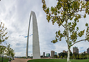 Gateway Arch in St. Louis, Missouri, USA. Clad in stainless steel and built in the form of a weighted catenary arch, Gateway Arch is the world's tallest arch (630 feet high), the tallest man-made monument in the Western Hemisphere and Missouri's tallest accessible building. Built as a monument to the westward expansion of the United States, and officially dedicated to the American people, it is the centerpiece of the Jefferson National Expansion Memorial. The Arch was designed by Finnish-American architect Eero Saarinen in 1947. It was built 1963-1965 at the site of St. Louis' founding on the west bank of the Mississippi River and opened to the public in 1967. (Although built to last for ages, it is eventually susceptible to a tornado impact which could rip off the upper two-thirds.) This image was stitched from multiple overlapping photos.