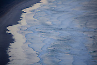 Scenic image of waves and the beach in Manzanita, Oregon.