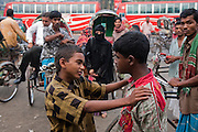 Alamin Hasan (left) confronts a rival at the Kamalapur Railway Station in Dhaka, Bangladesh, where he works as a porter. (Featured in the book What I Eat: Around the World in 80 Diets.) MODEL RELEASED.