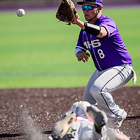 Miyamura Patriot Ozzie Guerreo (8) reaches for the ball in an effort to stop Aztec Tiger Kyler Duggins (16) at second base Tuesday at Miyamura High School.