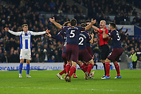 Football - 2018 / 2019 Premier League - Brighton and Hove Albion vs. Arsenal<br /> <br /> The Arsenal players surround Referee Mr Anthony Taylor as they think he's awarded a goal to Brighton only for him to be pointing for a free kick at The Amex Stadium Brighton <br /> <br /> COLORSPORT/SHAUN BOGGUST