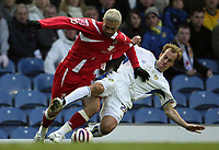 Photo: Paul Thomas/Sportsbeat Images.<br /> Leeds United v Swindon Town. Coca Cola League 1. 17/11/2007.<br /> <br /> Jamie Clapham (R) of Leeds tries to stop Christian Roberts.