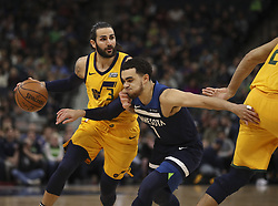 April 1, 2018 - Minneapolis, MN, USA - Utah Jazz guard Ricky Rubio (3) drives against Minnesota Timberwolves guard Tyus Jones (1) in the first quarter on Sunday, April 1, 2018 at Target Center in Minneapolis, Minn. (Credit Image: © Jeff Wheeler/TNS via ZUMA Wire)