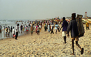 Crowds on Dakar Beach wait for the fishing boats to return - Senegal