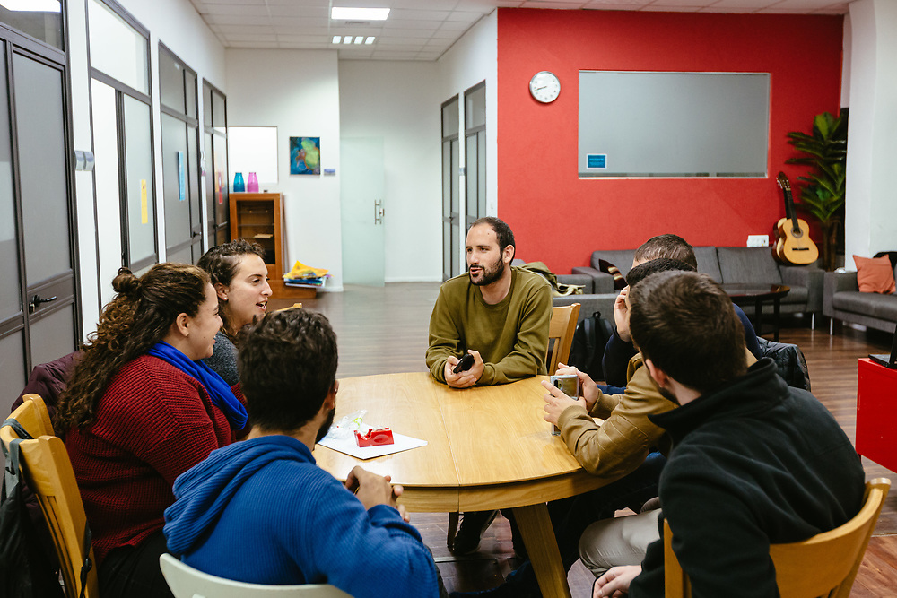 Two English-speaking volunteers (2nd, 3rd Left) talk with former ultra-Orthodox Jewish Israelis that have left the strict Jewish religious communities in which they lived for most of their lives, during an evening English lesson at the Hillel - The Right to Choose center in central Jerusalem, Israel, on November 25, 2019. Hillel - The Right to Choose is an Israeli non-profit organization dedicated to helping young adults who have left the ultra-Orthodox Jewish world integrate and lead successful lives as members of secular Israeli society.