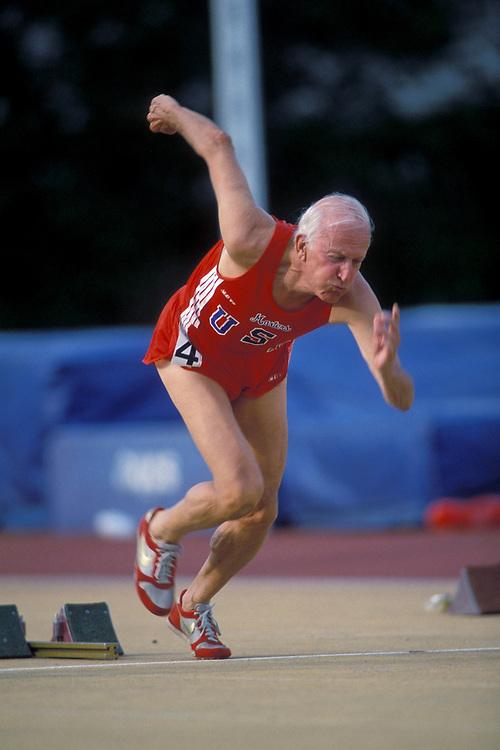 Elderly male at starting blocks for 100 meter race at National Senior Olympics at Baton Rouge, LA. ©Bob Daemmrich /