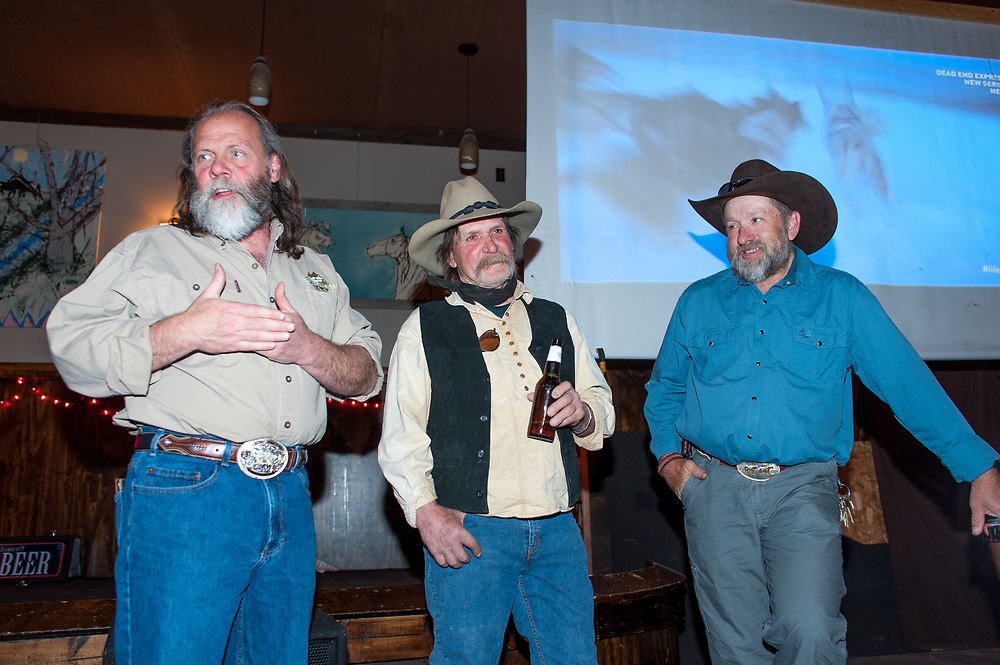 Andy Breland, Bud Petryszak, and Chuck Allen talking to guests and answering questions about the filming of Dead End Express at the premier party.