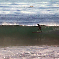USA, California, San Diego. Surfer cutting the wave at Cardiff by the Sea.