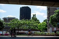 © Licensed to London News Pictures. 17/06/2017. London, UK. View showing Grenfell tower block in west London following a devastating fire earlier this week. The blaze engulfed the 27-storey building killing 12 - with 34 people still in hospital, 18 of whom are in critical condition. The fire brigade say that they don't expect to find anyone else alive. Photo credit: Ben Cawthra/LNP