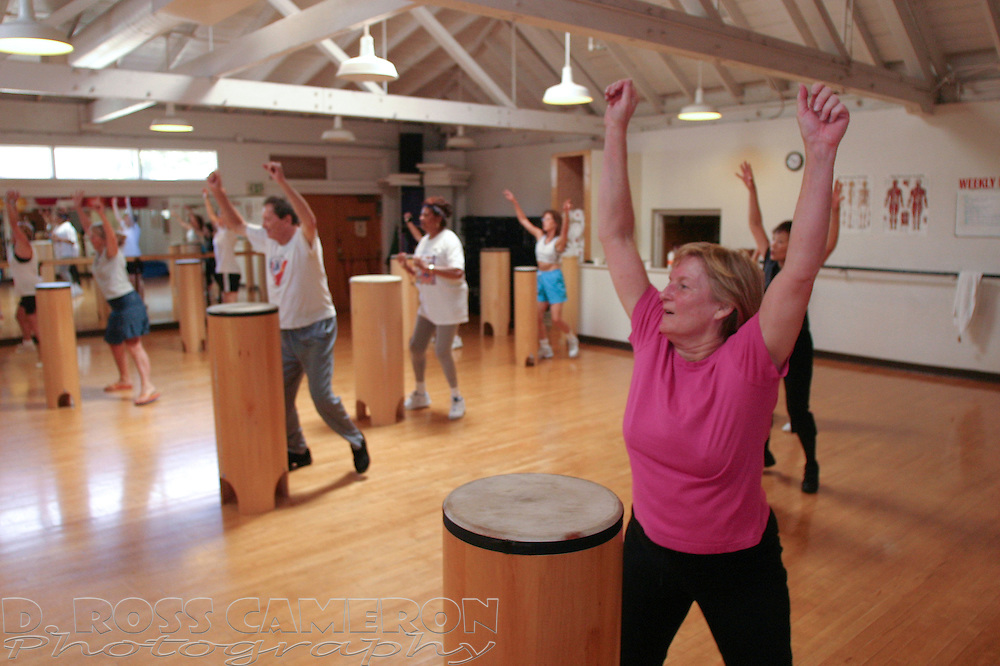 """Members of a """"Total Rhythm Fitness"""" class work out at the Courthouse Athletic Club in Oakland, Calif., Tuesday, Aug. 2, 2005. Bored with aerobics and jazzercise, fitness afficionadoes are seeking out new methods for keeping their interest in exercise. (Photo by D. Ross Cameron)"""