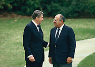 President Reagan and Ambassador Phillip Habib outside of the Oval Office on March 7, 1986.<br />Photo by Dennis Brack