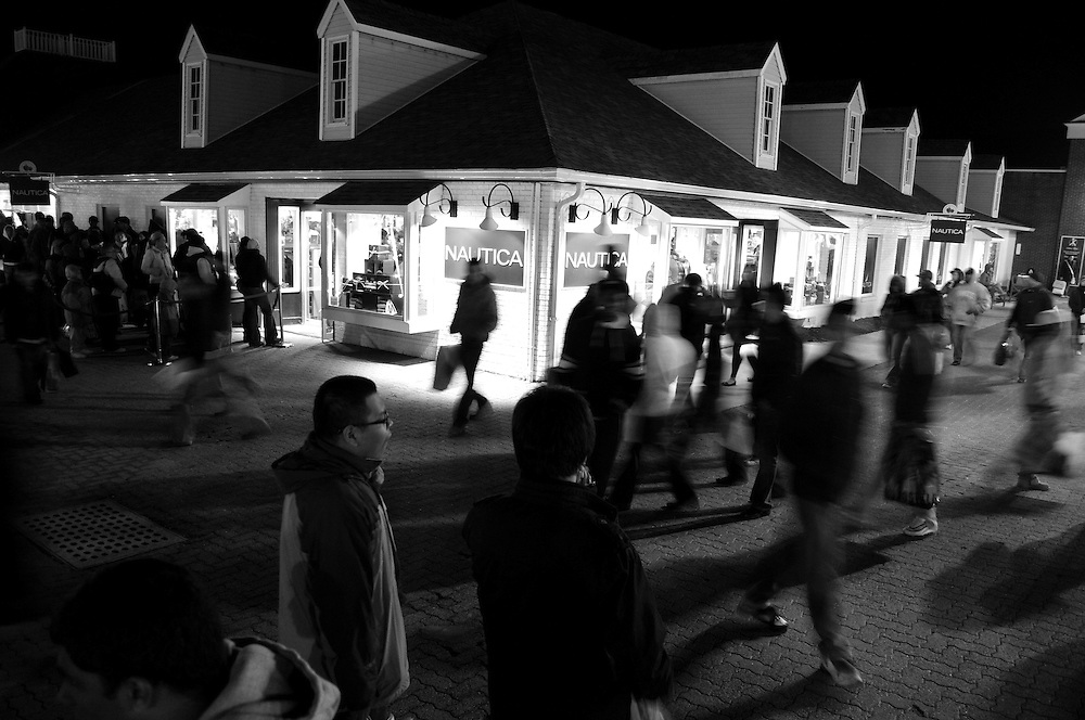 Crowds of shoppers make their way through the outdoor outlet mall on Black Friday Nov. 28 2008.
