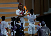 Naomi Osaka receives the Olympic Torch during the Opening Ceremony of the Tokyo 2020 Olympic Games. Tuesday 27th July 2021. Mandatory credit: © John Cowpland / www.photosport.nz