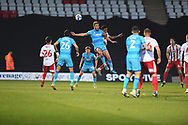Cheltenham Town Forward Sam Smith(9) and Stevenage defender Terence Vancooten(15)  challenges for a header  during the EFL Sky Bet League 2 match between Stevenage and Cheltenham Town at the Lamex Stadium, Stevenage, England on 20 April 2021.