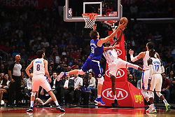 October 19, 2018 - Los Angeles, CA, U.S. - LOS ANGELES, CA - OCTOBER 19: Los Angeles Clippers Center Boban Marjanovic (51) steals the rebound from Oklahoma City Thunder Forward Jerami Grant (9) and scores and is fouled during a NBA game between the Oklahoma City Thunder and the Los Angeles Clippers on October 19, 2018 at STAPLES Center in Los Angeles, CA. (Credit Image: © Brian Rothmuller/Icon SMI via ZUMA Press)