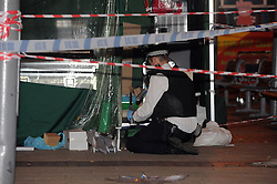 © Licensed to London News Pictures. 22/08/2013<br /> Police officer placing a knife in evidence tube.<br /> A man has been in stabbed in Bexleyheath this evening. Emergency services were called to the Broadway, near McDonalds, at 8.15pm  tonight (22.08.2013) The man, aged in his late 50s, was treated at the scene before being rushed to a south London hospital with a stab wound where his condition is desribed as stable. <br /> A man was arrested in connection with the incident and has in custody in a south London police station. Police have cordoned off a large section of the Broadway following the incident. <br /> Photo credit :Grant Falvey/LNP