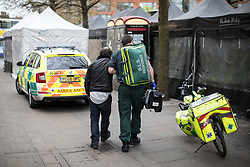 © Licensed to London News Pictures . 06/04/2017 . Manchester , UK . A paramedic tends to a man , believed to have taken spice in a telephone box . An epidemic of abuse of the drug spice by some of Manchester's homeless population , in plain sight , is causing users to experience psychosis and a zombie-like state and is daily being witnessed in the Piccadilly Gardens area of Manchester , drawing large resource from paramedic services in the city centre . Photo credit : Joel Goodman/LNP