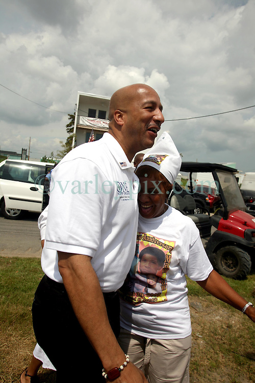 August 29 2009. Lower 9th Ward, New Orleans, Louisiana.<br /> 4th Anniversary of Hurricane Katrina remembered.<br /> Mayor Ray C Nagin greets a Lower 9th ward resident on Tennessee Street.<br /> Photo; Charlie Varley/varleypix.com