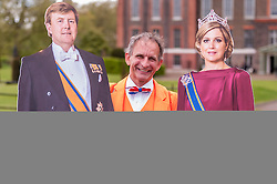 © Licensed to London News Pictures. 03/05/2015. London, UK. A man from Holland, with cardboard cut-outs of the King and Queen of the Netherlands, is amongst well-wishers who visited  Kensington Palace to show support for the new daughter of the Duke and Duchess of Cambridge who was born the previous day. Photo credit : Stephen Chung/LNP