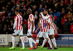 Stoke City's Joe Allen (second right) is congratulated by team mate Ashley Williams after scoring his side's second goal during the Sky Bet Championship match at the bet365 Stadium in Stoke.