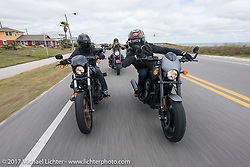 Anthony Paggio (L) rides alongside his friend and custom bike builder Jesse Rooke on a new 2017 Harley-Davidson 750 Street Rod rides A1A near Flagler Beach during Daytona Beach Bike Week. FL. USA. Tuesday, March 14, 2017. Photography ©2017 Michael Lichter.
