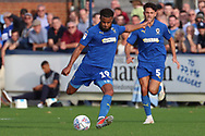 AFC Wimbledon midfielder Tom Soares (19) passing the ball during the EFL Sky Bet League 1 match between AFC Wimbledon and Portsmouth at the Cherry Red Records Stadium, Kingston, England on 13 October 2018.